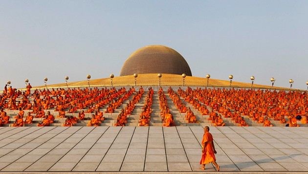 Buddhist monks pray at the Wat Phra Dhammakaya temple